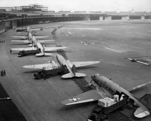 More details C-47 Skytrains unloading at Tempelhof Airport during the Berlin Airlift.
