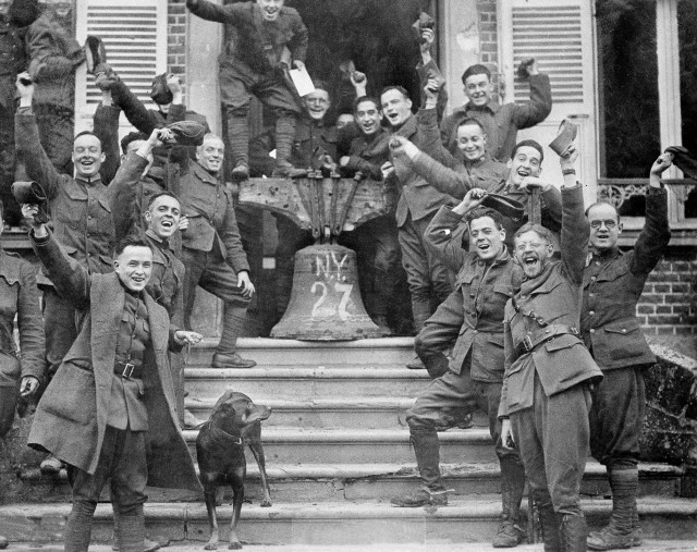 New York troops in Corbie, France, celebrate the signing of the Armistice Treaty, Nov. 11, 1918.
